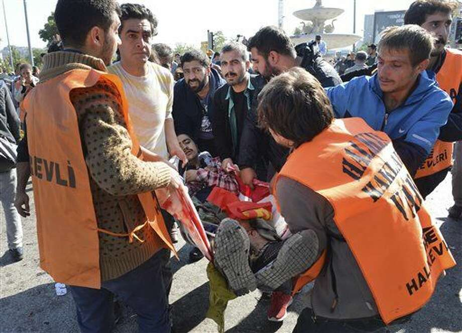 People carry a wounded man at the site of an explosion in Ankara, Turkey, Saturday. Photo: AP Photo