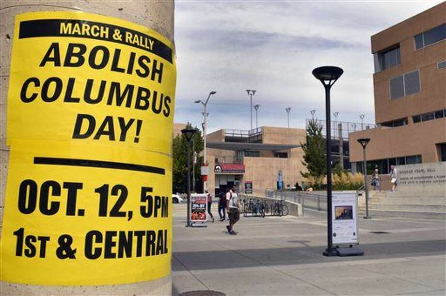 A flyer on the campus of the University of New Mexico in Albuquerque calls for students to join a protest against Columbus Day. Monday marks the annual Columbus Day nationwide, but in a twist that signals a growing trend, it will also be Indigenous Peoples Day in at least nine U.S. cities this year. Photo: Russell Contreras | AP Photo
