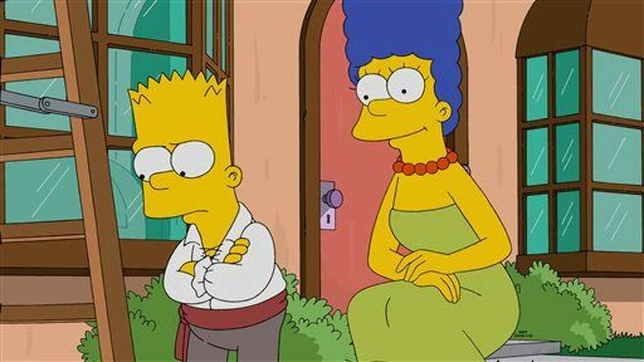 """In this photo provided by FOX, Marge, right, promises to make Halloween fun for Bart, left, in the all-new """"Halloween Horror"""" episode of """"The Simpsons,"""" that aired Sunday. Mickey Mouse, Bart Simpson and Scooby-Doo will share the limelight in a TV special paying tribute to cartoon characters. FOX said Thursday it will air a two-hour program, """"TV's Funniest Animated Stars: A Paley Center for Media Special,"""" honoring 40 animated stars that have touched fans with humor and even proven influential. Photo: FOX Via AP"""