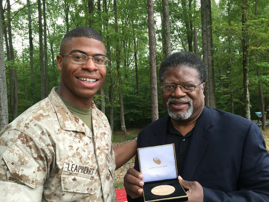 1st Lt. David Leapheart, U.S. Marine Corps, Quantico, left, and Theophilus Leapheart of Midland, accept the Congressional Gold Medal on behalf of the late Arvell Leapheart, their grandfather and father, respectively. Photo: Photo Provided