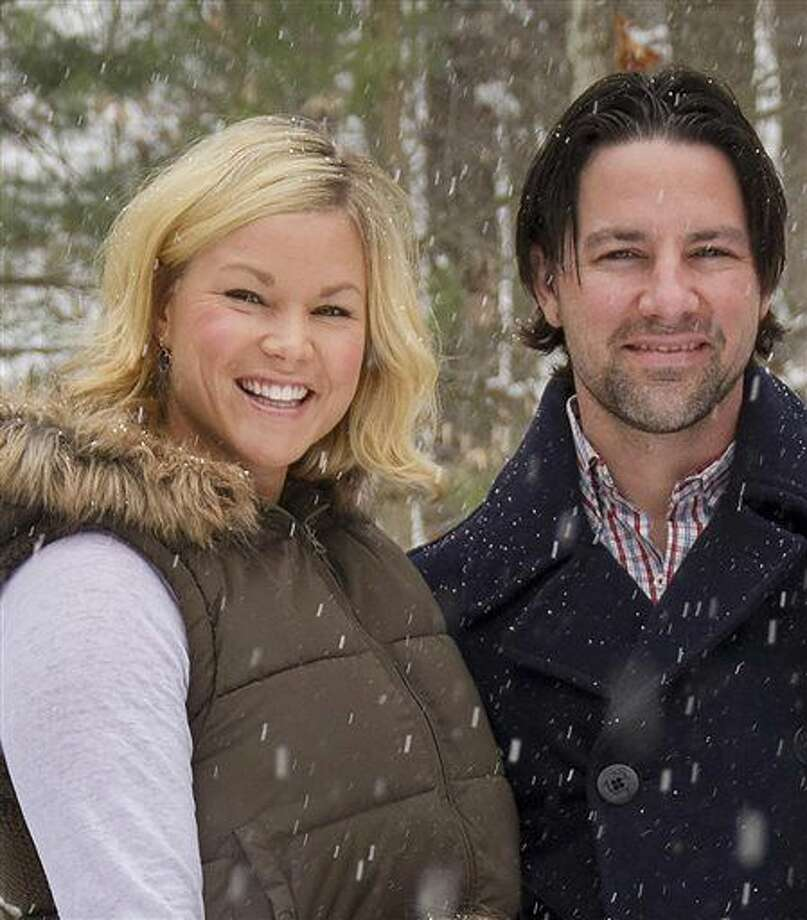 In this January 2014 photo, Thomas and Kelley Clayton pose in Caton, N.Y. Thomas Clayton, a former minor league hockey player has been charged with killing his wife inside their upstate New York home, authorities said. The Steuben County sheriff's office said deputies and state troopers responded to Thomas Clayton's home in Caton, near the Pennsylvania border, after he called 911 early Tuesday, Sept. 29, 2015, and said he found his wife dead. (Jeff Richards/The Star-Gazette via AP)  Photo: Jeff Richards