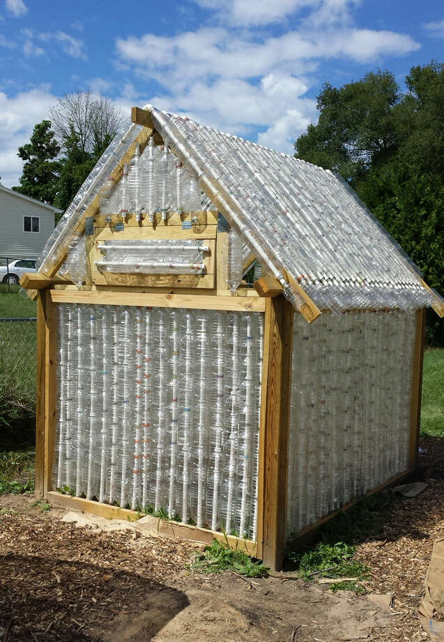 The Midland Section of theAmerican Chemical Society constructed this greenhouse out of recycled bottles at Creative 360 this summer. Photo: Photo Provided