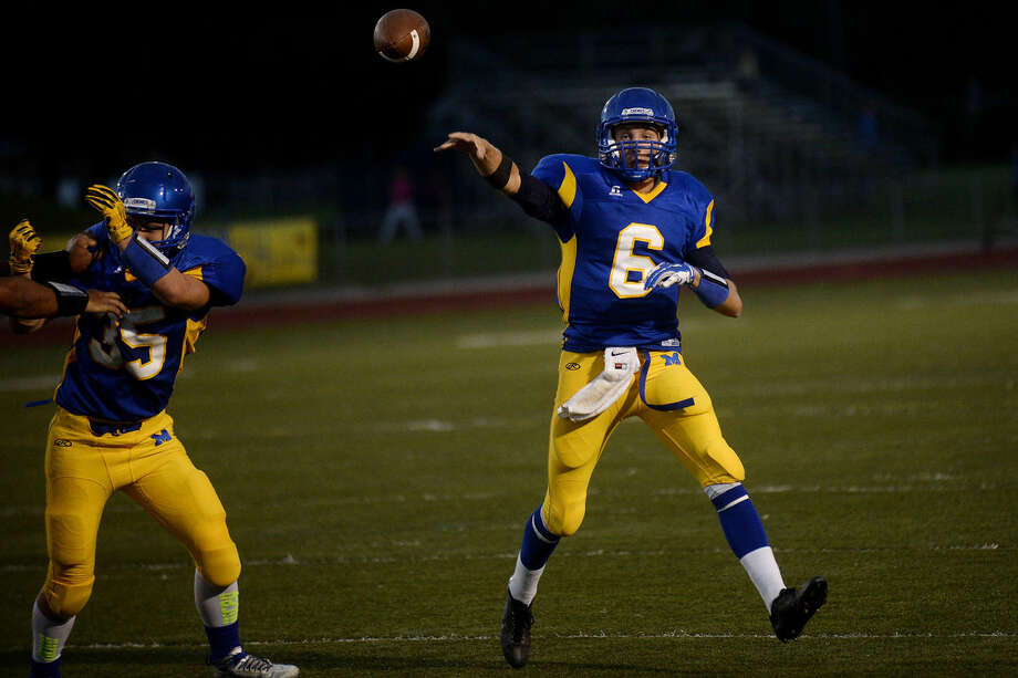 Midland High senior quarterback Payton DeWildt has been a driving force in the Chemics' 6-0 start. He leads the entire Saginaw Valley League with 1,276 passing yards. Photo: Nick King | Midland Daily News