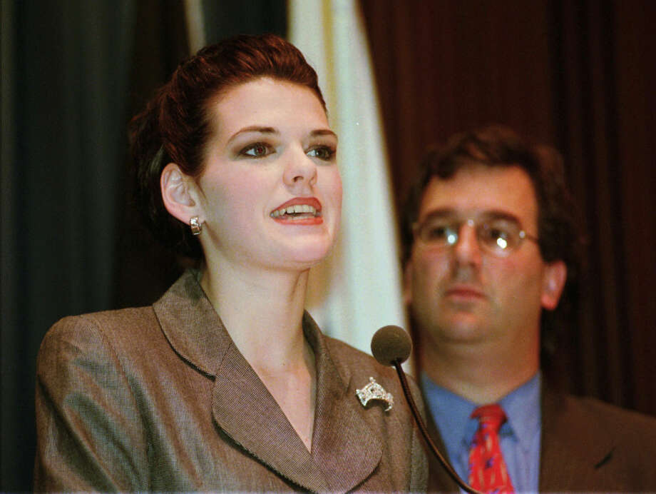 FILE - In this March 24, 1998 file photo, Miss America 1998 Kate Shindle addresses the Illinois House of Representatives at the State Capitol in Springfield, Ill. Brown University class being offered for the first time in the fall of 2015 is giving students the opportunity to examine how and why pageantry and femininity have become linked in the public consciousness. Students at Brown University who are enrolled in the Beauty Pageants in American Society class recently got a visit from 1998 Miss America Kate Shindle. Photo: AP Photo/Seth Perlman, File