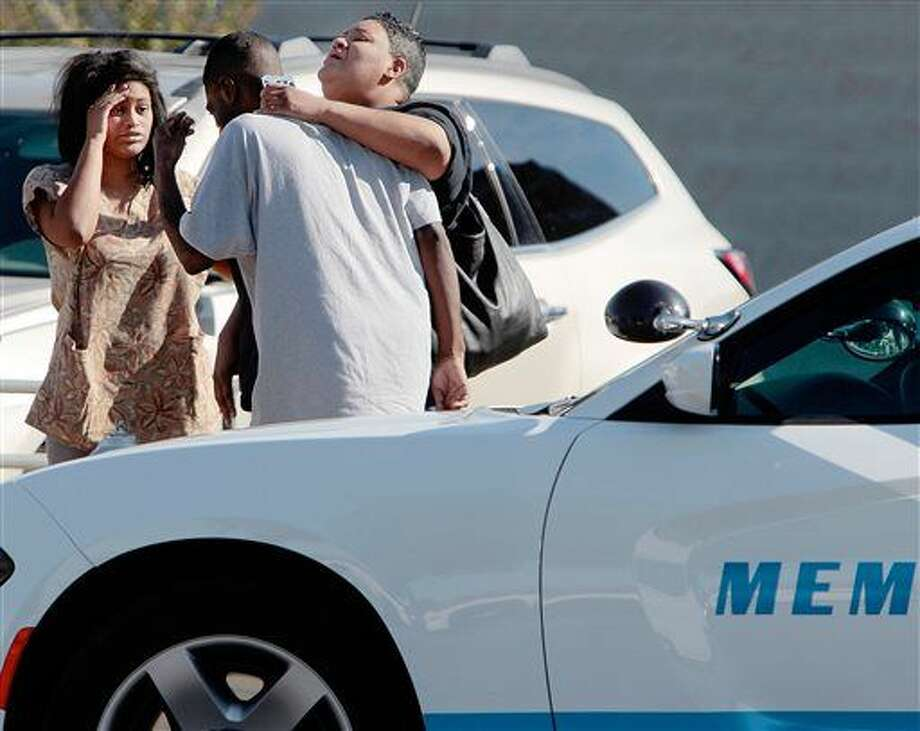 People wait outside the Regional Medical Center on Sunday in Memphis, Tenn. Memphis Police Director Toney Armstrong said Memphis Police Officer Terence Olridge was killed after being shot multiple times while off duty on Sunday. Photo: Jim Weber | The Commercial Appeal Via AP