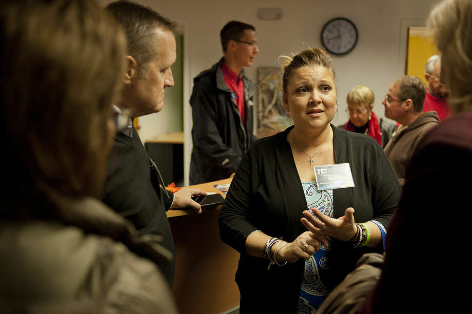 Ten16 Recovery Network's new Center for Recovery & Wellness supervisor Beth Ureche, center, talks with, from left, Dan Erdman, Susan Erdman and Drewe Robinson during the open house for the center. Photo: Brittney Lohmiller | Midland Daily News