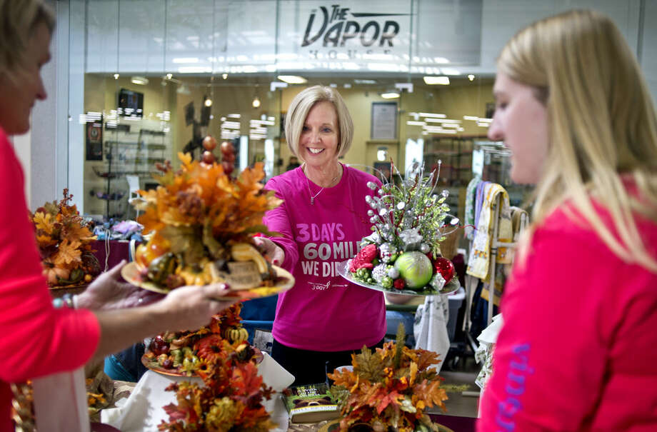 Midland resident Mary Beth Mitchell sells thanksgiving-themed centerpieces to benefit the Susan G. Komen Foundation. Mitchell has completed 11 60-mile, three-day walks for breast cancer since 2002 and recently returned from one in Philly. Photo: Erin Kirkland | Midland Daily News