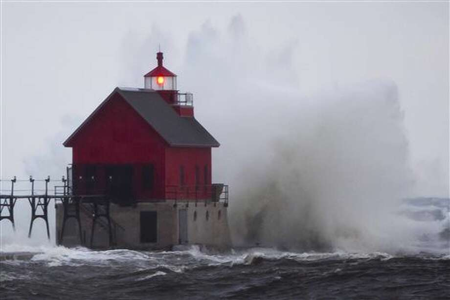 A Lake Michigan wave crashes into Grand Haven's south pier Thursday, Oct. 29, 2015, near Grand Haven, Mich. High winds are causing scattered power outages in Michigan and bringing warnings about high waves on the Great Lakes. (Cory Morse/The Grand Rapids Press via AP) Photo: Cory Morse