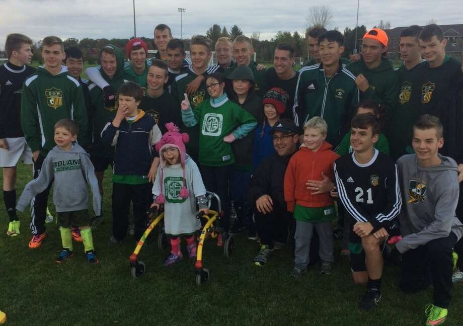 """Dow High boys' soccer players acted as """"Buddies"""" for young soccer players with special needs on Tuesday's final day of the fall season for the Midland Soccer Club's TOPSoccer program."""