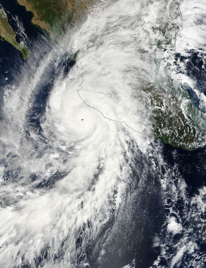 This satellite image taken at 1:30 p.m. EDT on Friday, Oct. 23, 2015, and released by NASA, shows the eastern quadrant and pinhole eye of Hurricane Patricia moving towards southwestern Mexico. The Category 5 storm is strongest ever in the Western Hemisphere, according to forecasters. (Goddard MODIS Rapid Response Team/NASA via AP) Photo: HOGP