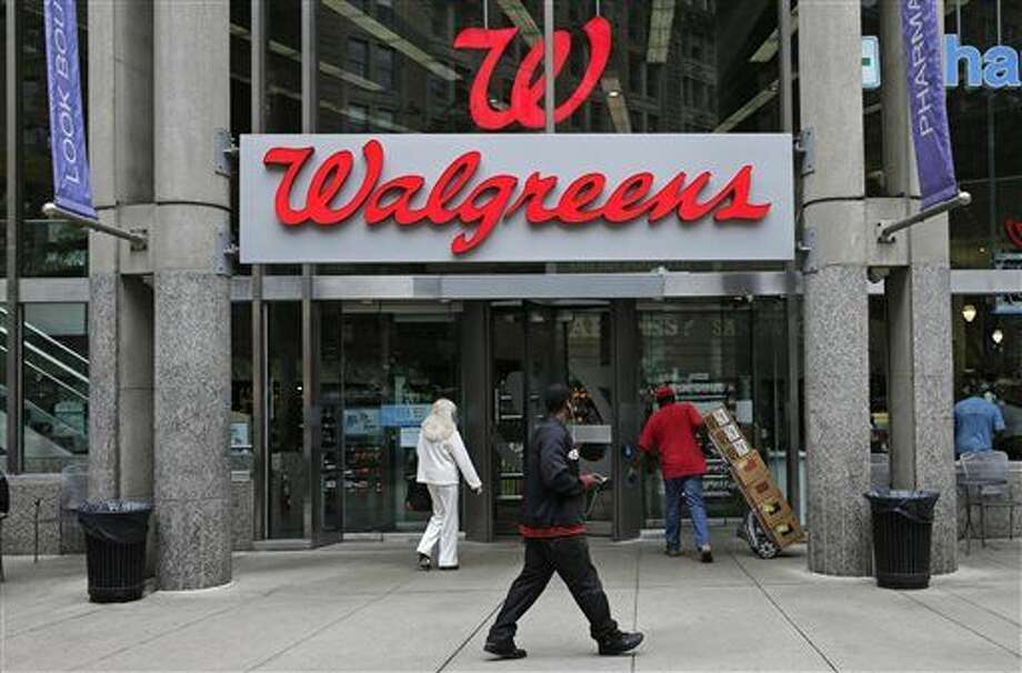 FILE - This June 4, 2014, file photo shows a Walgreens retail store in Boston. Walgreens confirmed Tuesday, Oct. 27, 2015, that it will buy rival Rite Aid, creating a drugstore giant with nearly 18,000 stores around the world. (AP Photo/Charles Krupa, File) Photo: Charles Krupa