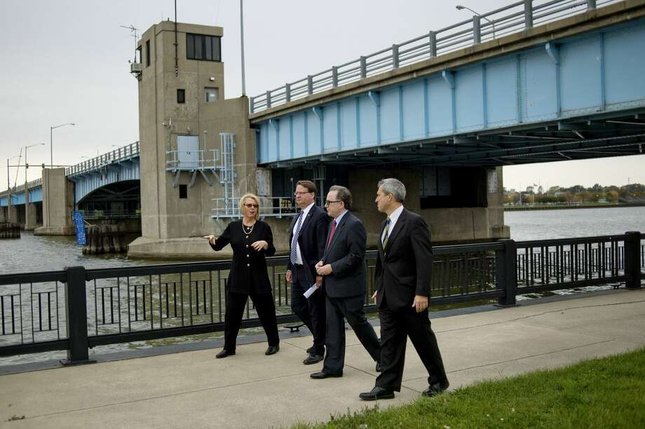 U.S. Sen. Gary Peters, D-Mich., second from left, tours the Bay City Riverfront with, from left, Great Lakes Bay Regional Convention & Visitors Bureau President/CEO Annette Rummel, Bay County Executive Tom Hickner and Bay County Drain Commissioner Joseph Rivet on Monday. Photo: Nick King | Midland Daily News