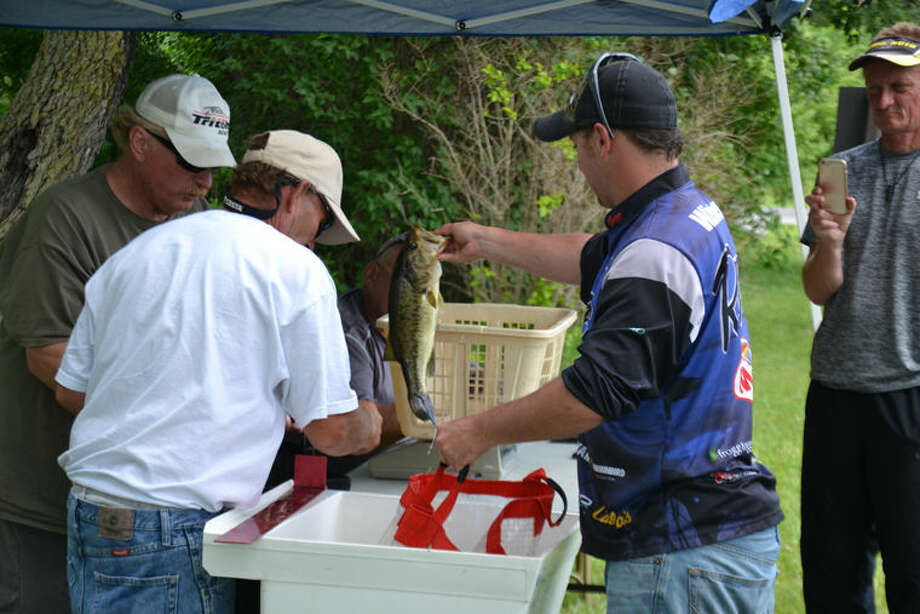 """Even though a report on Wixom Lake's fish calls smallmouth and largemouth bass populations """"modest"""", anglers such as these competitors in the Wixom Lake Open tournament earlier this month found plenty of targets for the jigs, plastic worms, surface plugs and other lures. Photo: Steve Griffin   For The Daily News"""