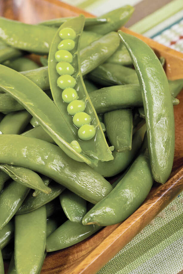 Harvest when pods are filled with young, tender peas that have not become starchy. Photo: Metro Services