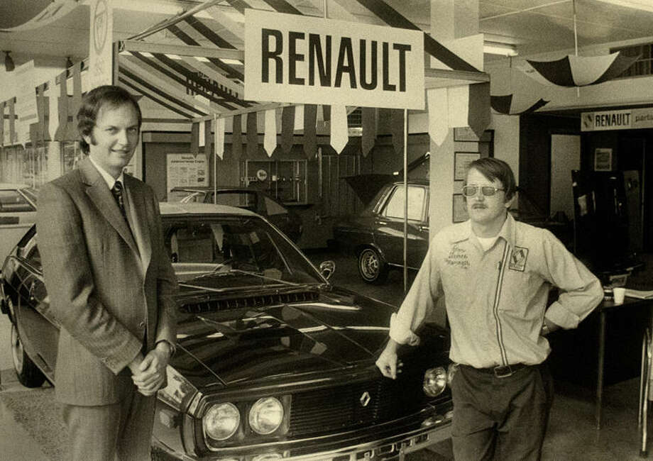 Ian Dove, left, car salesman, and James J. Hughes, service manager, show off one of the models of Renault cars which the Boulevard Motorcars Inc., 221 South Saginaw, is displaying.