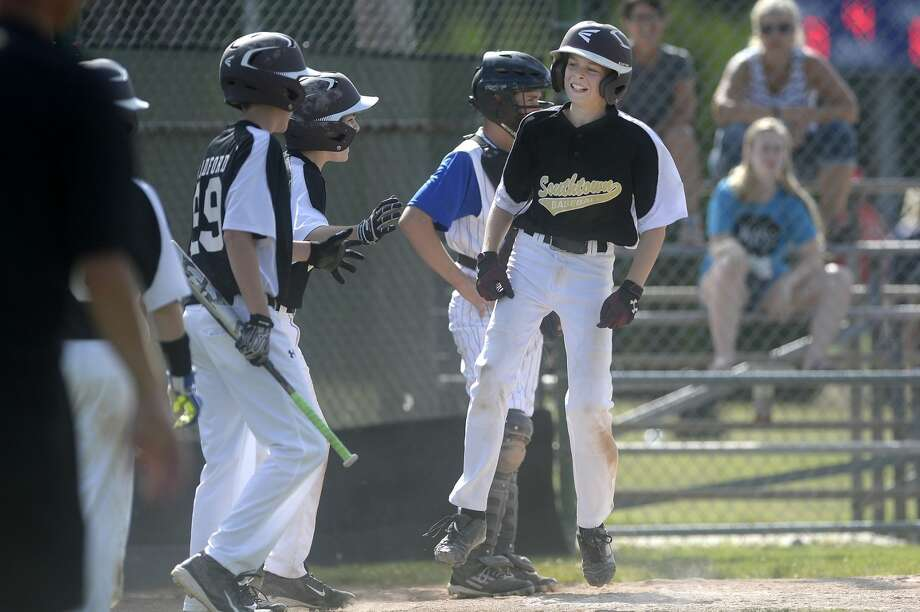 Southtown's Carter Campau celebrates after hitting a home run in the fourth inning on Monday at Northeast Little League. Southtown beat Northeast 15-2 in four innings. Photo: Nick King | Nking@mdn.net