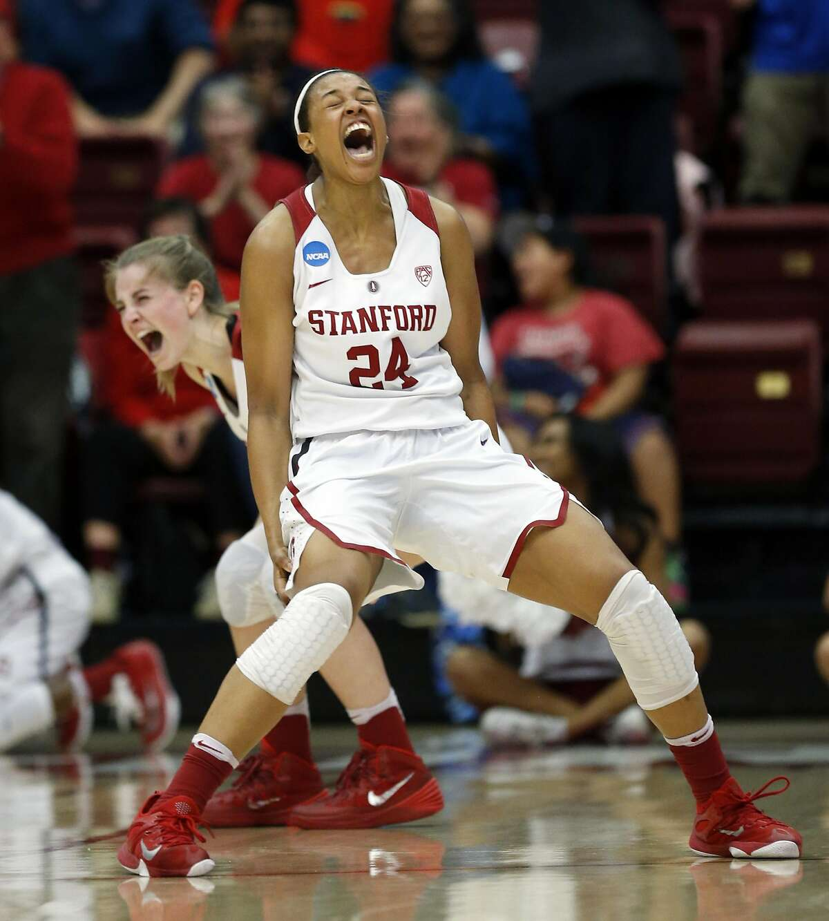 Stanford's Erica McCall (24) and Karlie Samuelson celebrate Lili Thompson's basket and subsequent go-ahead free throw in final seconds of Stanford's 66-65 win over South Dakota State in 2016 NCAA Division 1 Women's Basketball Tournament game in Stanford, Calif., on Monday, March 21, 2016.