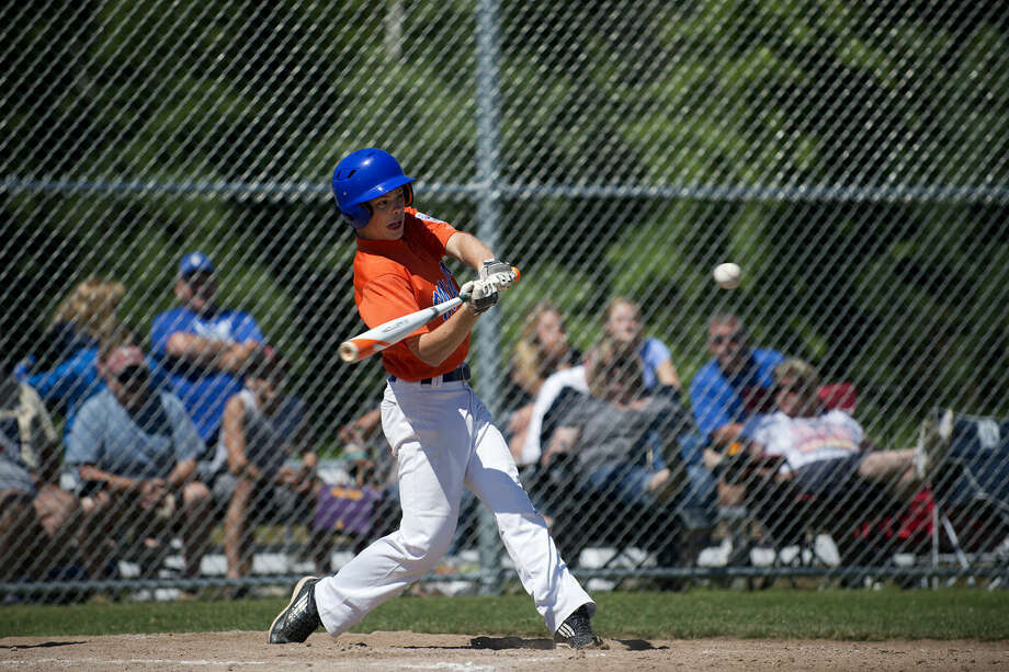 Midland Northeast/Fraternal Northwest's Zack Servinski swings at a pitch from Taylor's Dacota Whalen in the sixth inning on the first day of the Senior Little League Baseball state tournament in Larkin Township. Midland Northeast/Fraternal Northwest lost 6-4. Photo: Brittney Lohmiller | Blohmiller@mdn.net