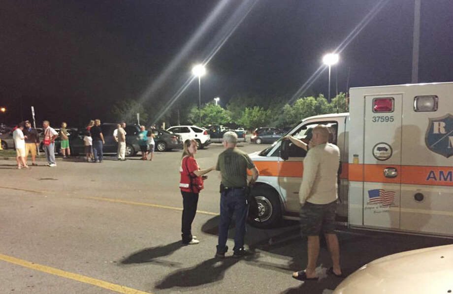 Emergency personnel stand by as evacuees gather at the Foothills Mall early this morning in Maryville, Tenn., after they were forced to leave their homes when rail car carrying a flammable and toxic gas derailed and caught fire. Photo: Brittany Bade | WBIR.com Via Associated Press