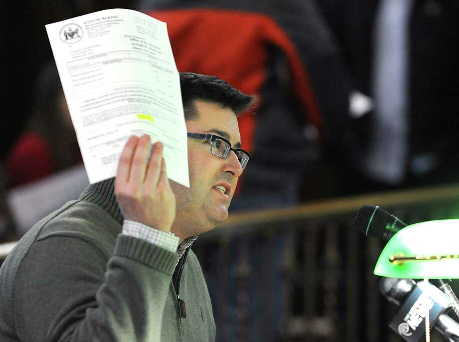 Albany County Legislator Chris Higgins of Albany holds up his trash bill and explains the trash tax is bad for business before the Albany Common Council at City Hall on Monday, March 21, 2016 in Albany, N.Y. There is to be a vote to repeal the Albany trash fee. (Lori Van Buren / Times Union) Photo: Lori Van Buren / 10035900A