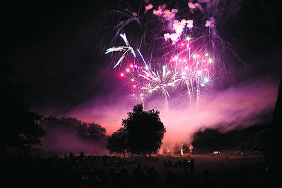 NEIL BLAKE | nblake@mdn.net Fireworks light up the sky at Chippewassee Park in Midland on Monday the Fourth of July. Thousands came to watch the show that capped off live music in the park. Photo: Neil Blake