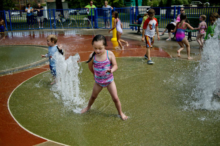 Faustina Poliskey, 8, of Midland, stands on one of the water fountains while playing on Monday at the Gerstacker Spray Park at Chippewassee Park. Poliskey was at the park with her mother for an obvious reason — to beat the heat. The spray park is open from dawn until dusk, weather permitting, until Oct. 1. Photo: Nick King/Midland Daily News
