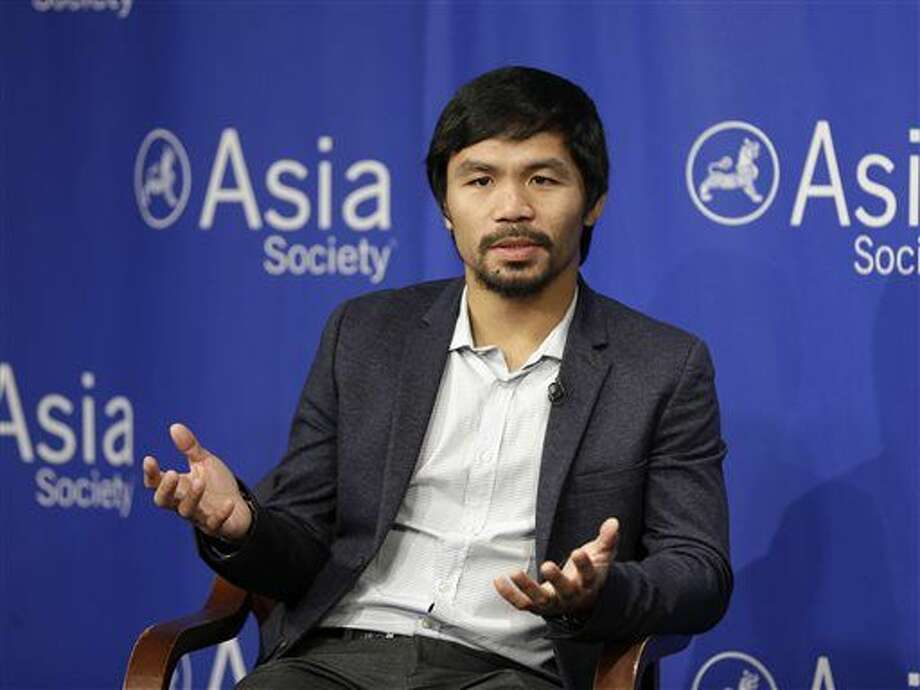 "FILE - In this Oct. 12, 2015, file photo, Manny Pacquiao takes questions at the Asia Society in New York. Boxing star Pacquiao has created a firestorm in his home country after saying people in same-sex relationships ""are worse than animals."" Pacquiao, who is running for a Philippine Senate seat, made the remark in a video posted Monday, Feb. 15, 2016, on local TV5's election site. He also said animals are better than people in same-sex relationships because they recognize the difference between males and females. (AP Photo/Seth Wenig, File) Photo: Seth Wenig"