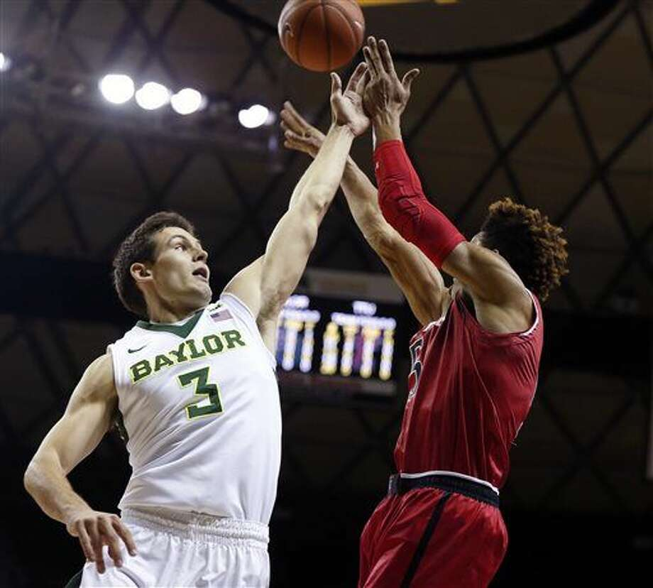 Texas Tech forward Justin Gray, right, is pressured by Baylor guard Jake Lindsey in the first half of an NCAA college basketball game, Saturday, Feb. 13, 2016, in Waco, Texas. (AP Photo/Rod Aydelotte) Photo: Rod Aydelotte