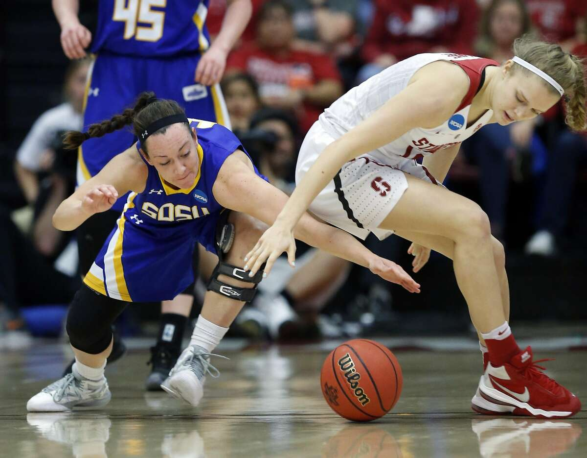 South Dakota State's Gabby Boever and Stanford's Brittany McPhee vie for loose ball in 3rd quarter during Stanford's 66-65 win in 2016 NCAA Division 1 Women's Basketball Tournament game in Stanford, Calif., on Monday, March 21, 2016.