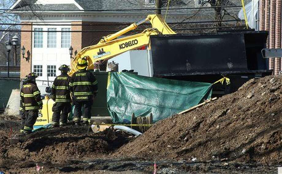 Police, firefighters and rescue workers work the scene of a construction accident involving a crane and a fallen generator at the future home of the Whippany Fire Company in Hanover, N.J., Thursday, Feb. 18, 2016. A five-ton generator fell from a crane at the construction site in northern New Jersey, killing at least one worker and severely injuring another. (Bob Karp/The Daily Record via AP) MANDATORY CREDIT Photo: Bob Karp