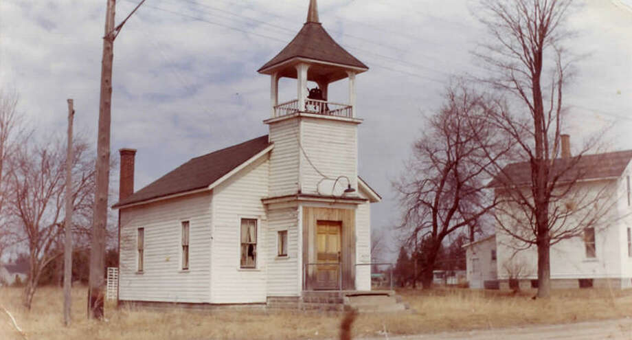 This is the little Methodist Church in Averill and now located on the Sanford Museum grounds and renamed the Clare Z. Bailey Chapel. A corner of the home that appears in the photo is the home where Becky and her husband Carl lived for many years. Called the Lanphierd House, it was built by a lumber baron, one of many who came to the Averill area for the white pine growing there.