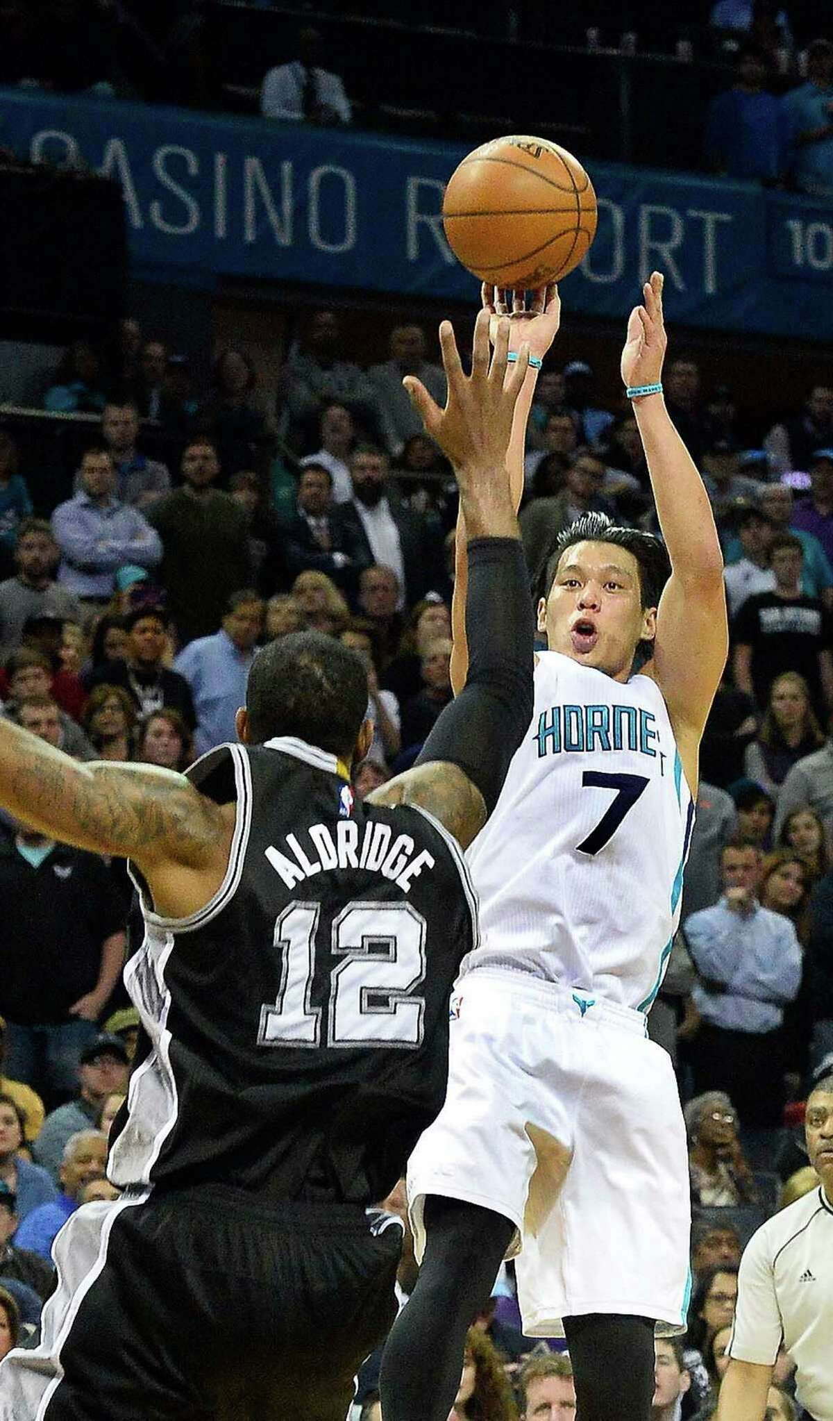 Charlotte Hornets guard Jeremy Lin shoots the ball over San Antonio Spurs forward LaMarcus Aldridge during Monday night's game at Time Warner Cable Arena on March 21, 2016 in Charlotte, N.C. The Charlotte Hornets defeated the San Antonio Spurs 91-88.