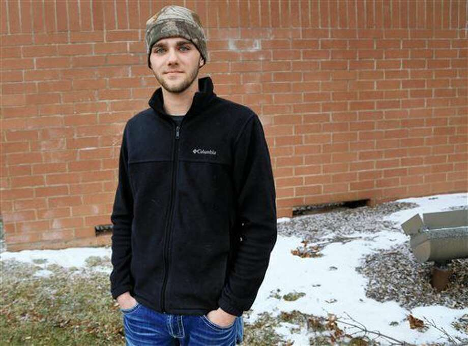 """In this Feb. 11, 2016 photo, Shaun McCarthy, of Avoca, Iowa, poses for a photo in Omaha, Neb. A boarding school for troubled teenagers in Iowa that is being investigated by the FBI routinely kept pupils in small concrete """"isolation boxes"""" for days or weeks and wouldn't let them out unless they sat in a specific posture for 24 hours, according to several former students including McCarthy. (AP Photo/Nati Harnik) Photo: Nati Harnik"""