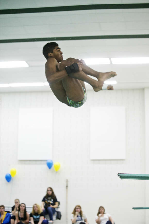 Dow High's Hunter Grannum dives during a meet against Midland High on Tuesday at the Dow pool. Grannum broke his own school record with a six-dive score of 310.90. Photo: Erin Kirkland/Midland Daily News