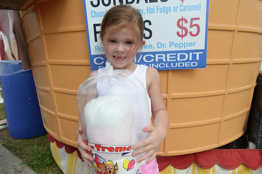 Madi Enderle, 5, of Kountze poses with her bag of cotton candy at the YMBL South Texas State Fair Friday. The fair opened early to accommodate the larger crowds anticipated on the Good Friday holiday. Photo taken Friday, April 3, 2015 Kim Brent/The Enterprise Photo: Kim Brent / Beaumont Enterprise