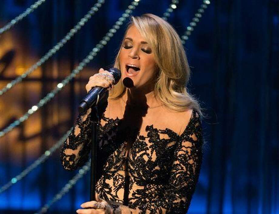 FILE - In this Dec. 2, 2015 file photo, country singer Carrie Underwood performs during the Sinatra 100 - An All-Star Grammy concert at The Wynn Las Vegas. Underwood, Kenny Chesney, Keith Urban, Florida Georgia Line and Cam are the first performers announced Thursday, Feb. 25, 2016, for the 51st annual Academy of Country Music Awards. The show will be broadcast live from the MGM Grand Garden Arena in Las Vegas on April 3 on CBS. (Photo by Eric Jamison/Invision/AP) Photo: Eric Jamison