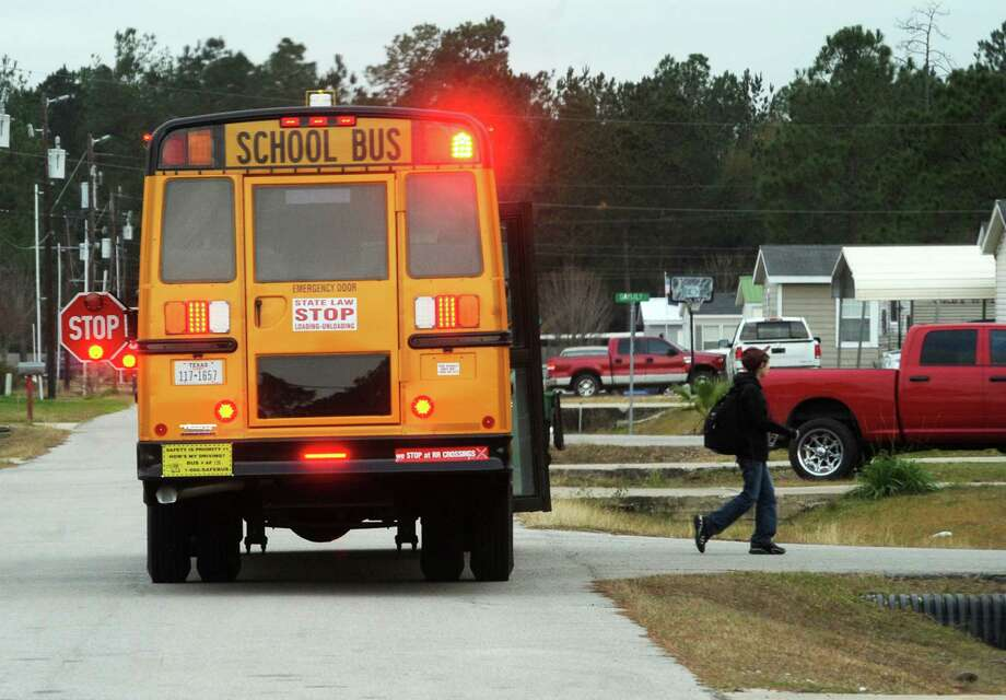 A Lumberton ISD bus drops off a student. Lumberton is one of three Hardin County school districts that will have early dismissal Thursday for Good Friday and the Easter holiday. Photo: Guiseppe Barranco, Photo Editor
