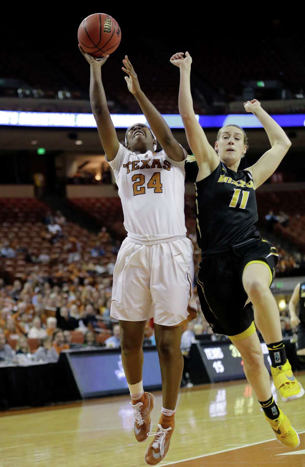 Texas' Ariel Atkins goes to the basket against Missouri's Lindsey Cunningham during the second-seeded Longhorns' second-round victory.