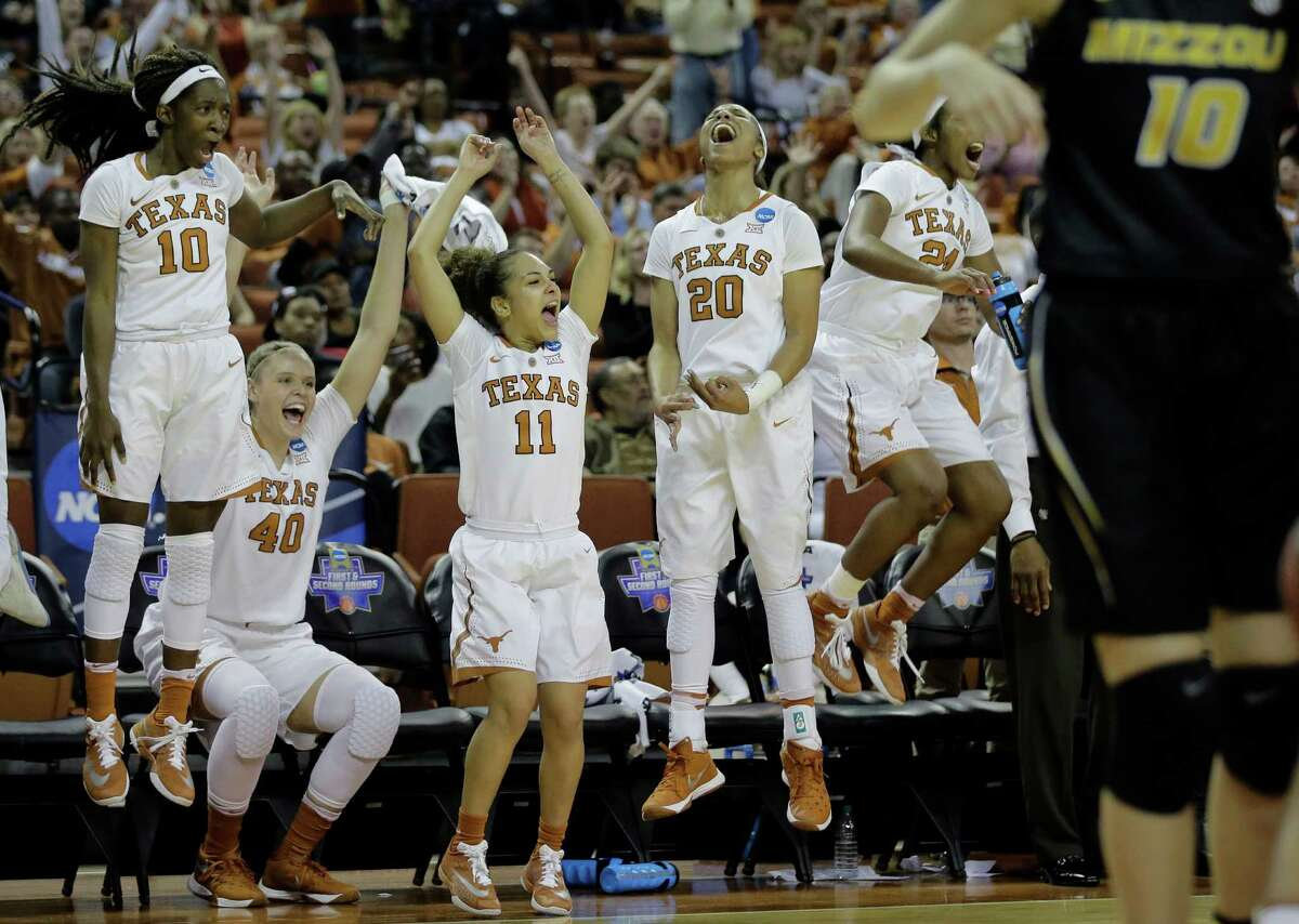 Texas players celebrate from the bench during their victory over Missouri. The Longhorns face third-seeded UCLA next.