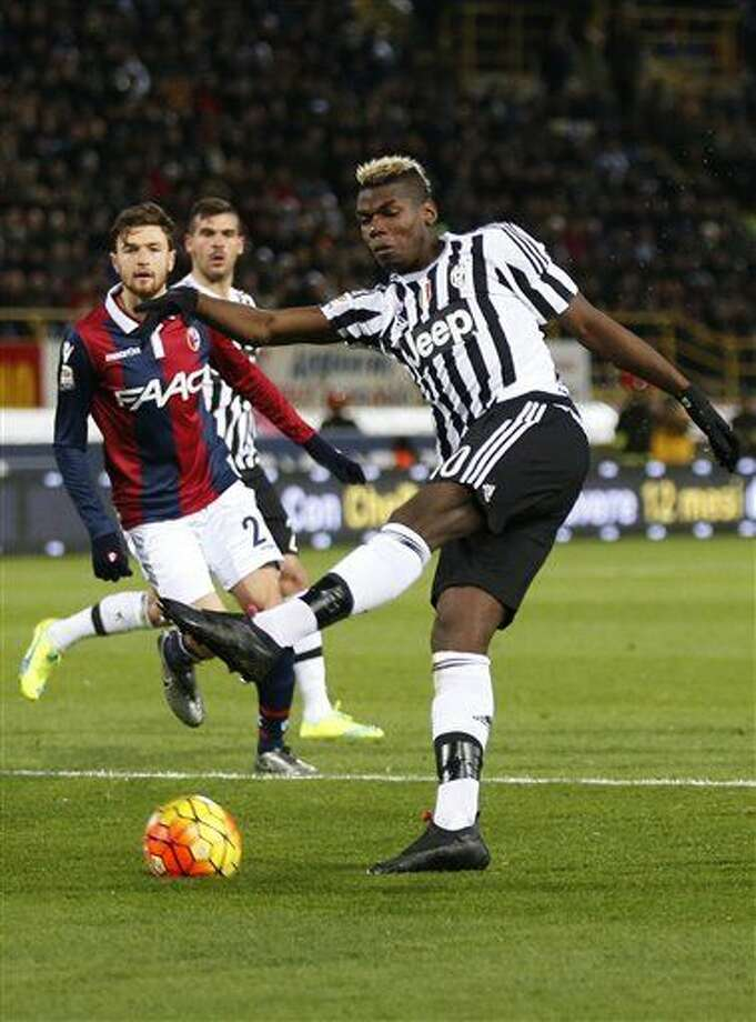 Juventus' Paul Pogba kicks the ball during the Serie A soccer match between Bologna and Juventus at the Dall' Ara stadium in Bologna, Italy, Friday, Feb. 19, 2016. (AP Photo/Antonio Calanni) Photo: Antonio Calanni