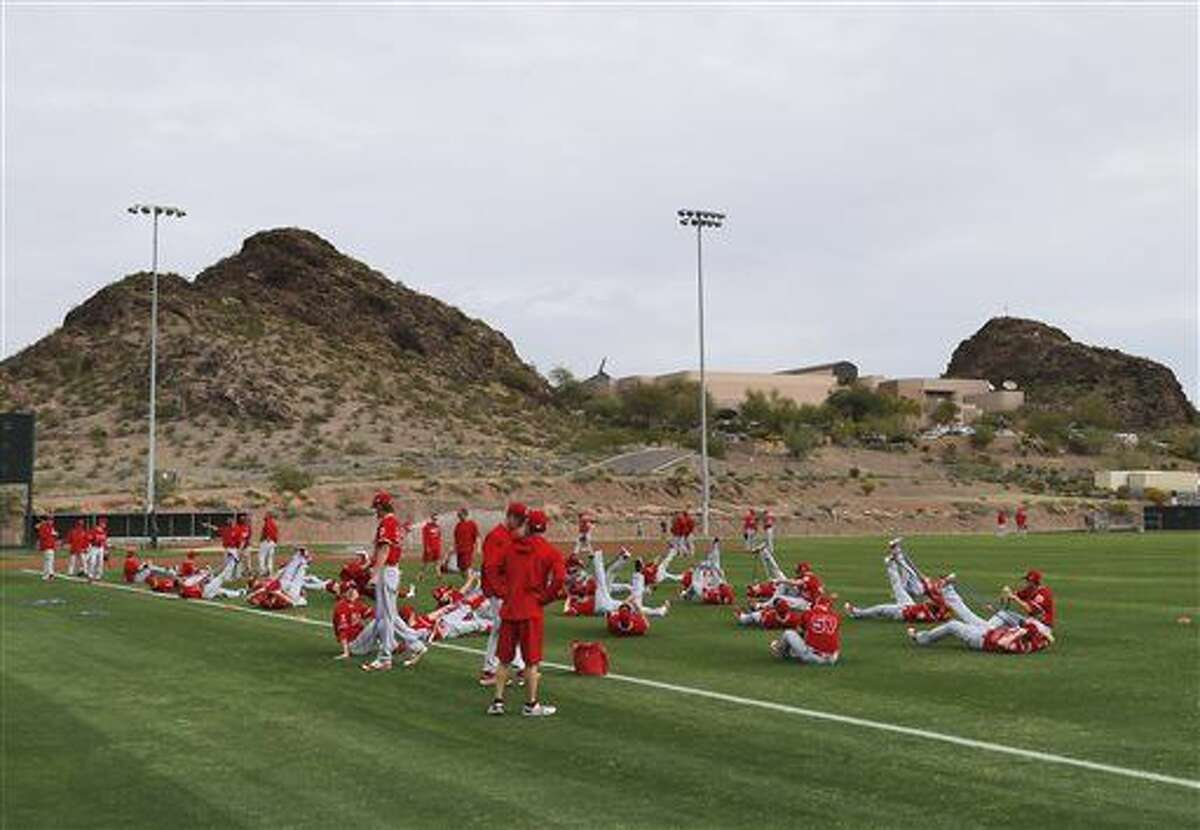 The Los Angeles Angels stretch during spring training baseball workouts, Friday, Feb. 19, 2016, in Tempe, Ariz. (AP Photo/Matt York)