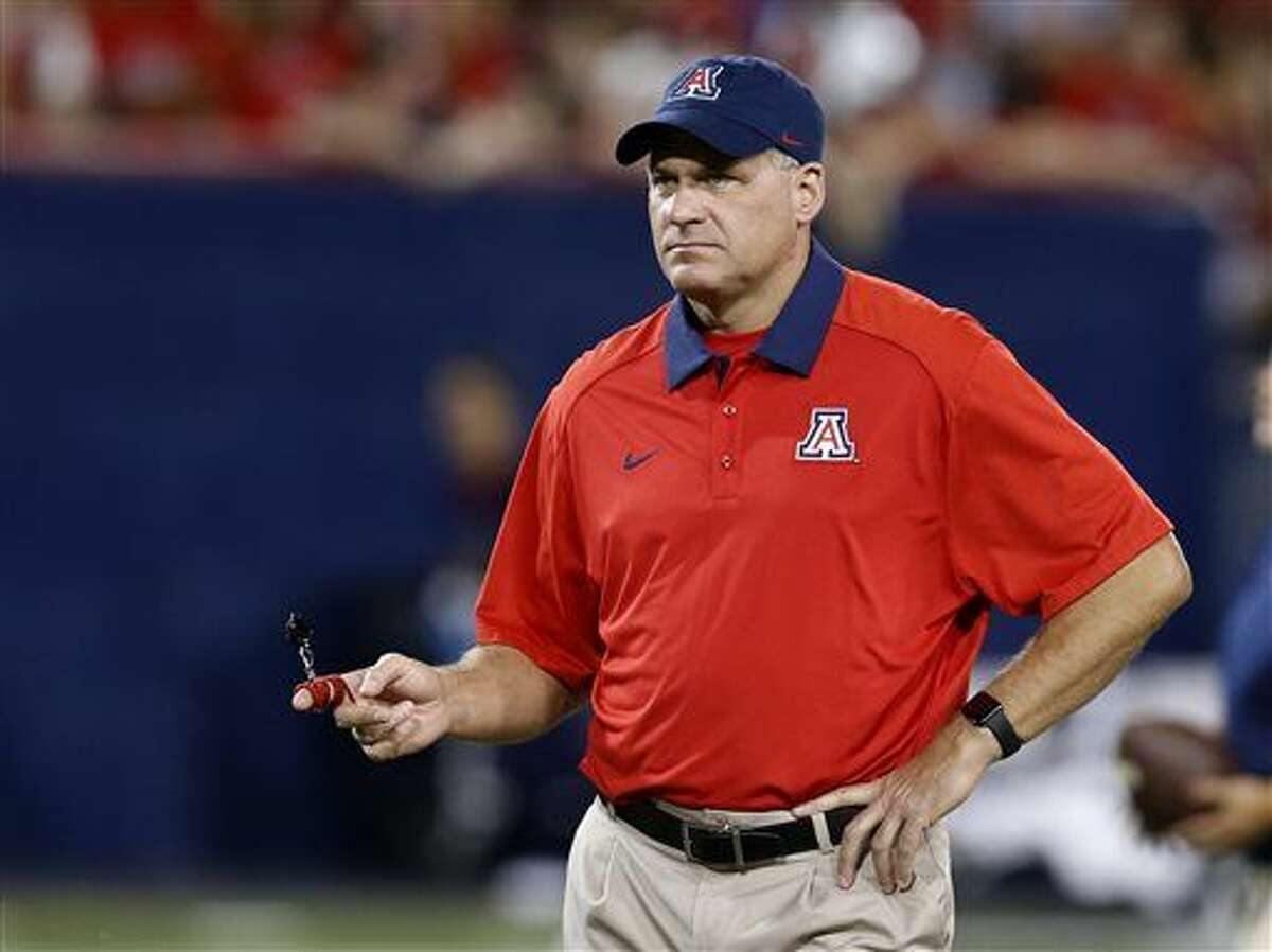 FILE - This Sept. 19, 2015 file photo shows Arizona head coach Rich Rodriguez during the second half of an NCAA college football game against Northern Arizona, in Tucson, Ariz. Spring comes early in college football or at least spring practice does. At Arizona, Rodriguez has decided to take a different approach in spring 2016. The Wildcats are focusing almost exclusively on fundamentals instead of schemes, and they won't be playing a spring game. (AP Photo/Rick Scuteri, File)