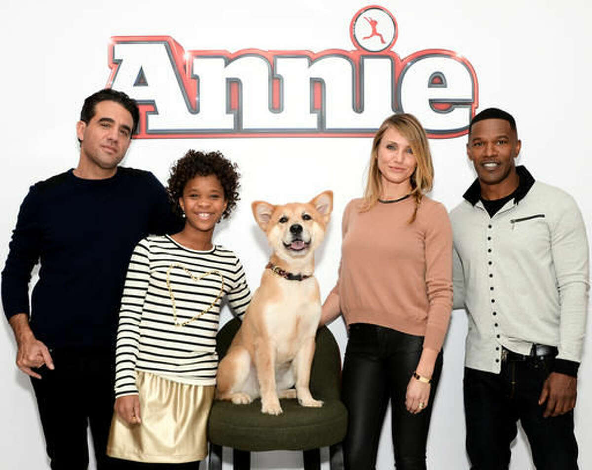"""FILE - In this Dec. 4, 2014 file photo, the cast of """"Annie"""" from left, Bobby Cannavale, Quvenzhane Wallis, Marty the dog, Cameron Diaz and Jamie Foxx poses during a photo call in New York. Movies make more money when exactly half the cast is non-white, according an annual analysis released Thursday, Feb. 25, 2016, that shows an even stronger connection between diversity and profits, and suggests how profoundly out of touch the motion picture academy is when giving Oscars only to white actors. (Photo by Evan Agostini/Invision/AP, File)"""