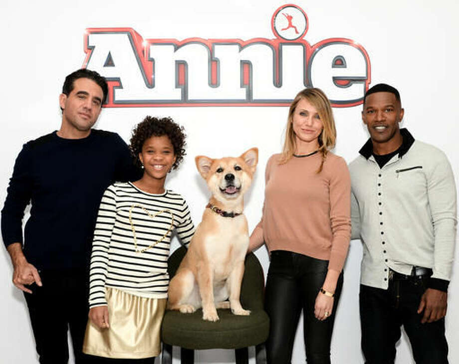 "FILE - In this Dec. 4, 2014 file photo, the cast of ""Annie"" from left, Bobby Cannavale, Quvenzhane Wallis, Marty the dog, Cameron Diaz and Jamie Foxx poses during a photo call in New York. Movies make more money when exactly half the cast is non-white, according an annual analysis released Thursday, Feb. 25, 2016, that shows an even stronger connection between diversity and profits, and suggests how profoundly out of touch the motion picture academy is when giving Oscars only to white actors. (Photo by Evan Agostini/Invision/AP, File) Photo: Evan Agostini"