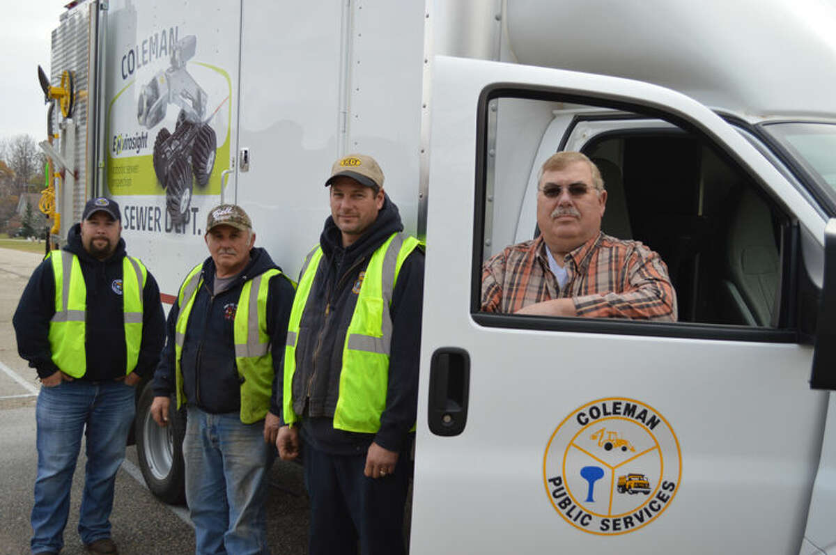 From left, City of Coleman DPW workers Eric Cozat, Don Haske, Todd Hasenfratz and Director Bill Cozat stand in front of the city's televising truck.