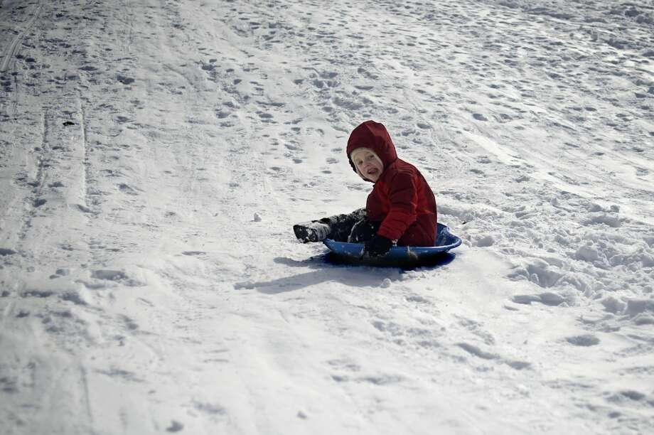Five-year-old Kai Truitt sleds down the hill at Revere Park on Thursday afternoon. Winter Storm Petros, which started around 11 a.m. on Wednesday, closed schools for a second day in Midland County and in surrounding areas.