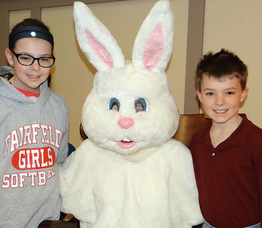 Mary Grace Kennedy, 12, and brother, Liam, 9, of Fairfield, visit with the Easter Bunny at a pancake breakfast Saturday at Fairfield Grace United Methodist Church. Photo: Fairfield Citizen / Mike Lauterborn / Fairfield Citizen