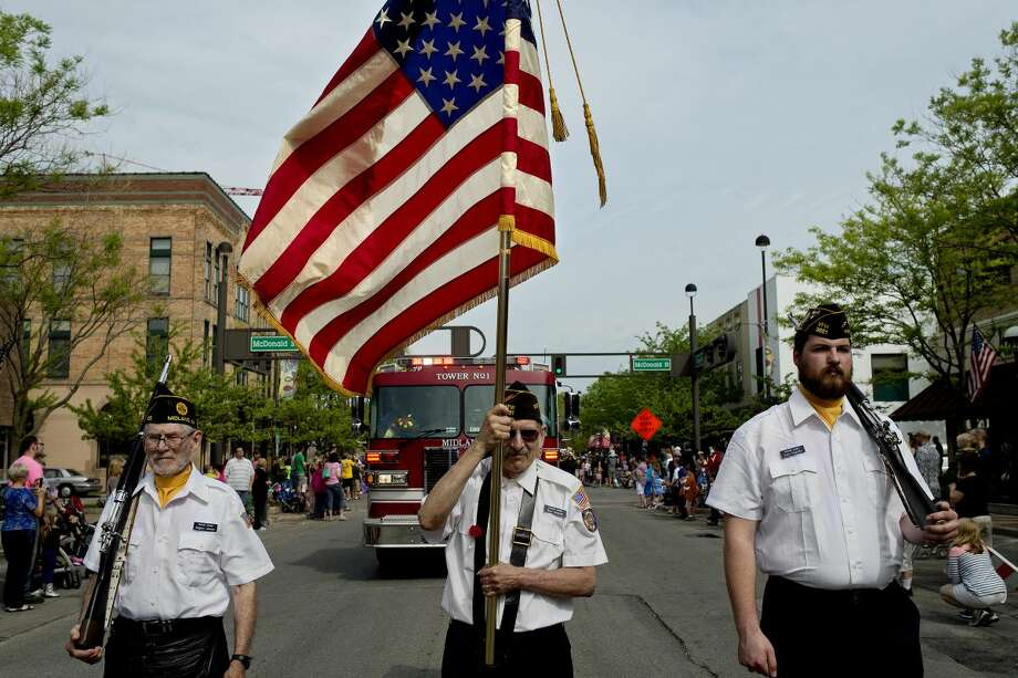 In this Daily News file photo, honor guard members, from left, Eugene Moore, Ron Schmidt and Evan Fryzelka march down Main Street as part of the Memorial Day parade in Midland.