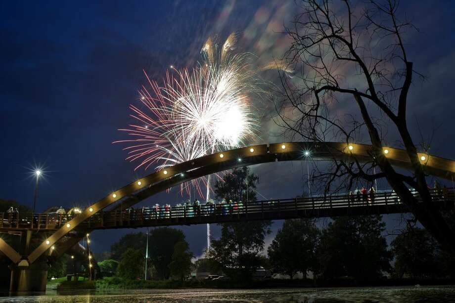 NICK KING | nking@mdn.net Fireworks explode in the sky over the Tridge on Saturday during the annual July 4th celebration at Chippewassee Park. The event featured live music, food and a fireworks display at dusk.