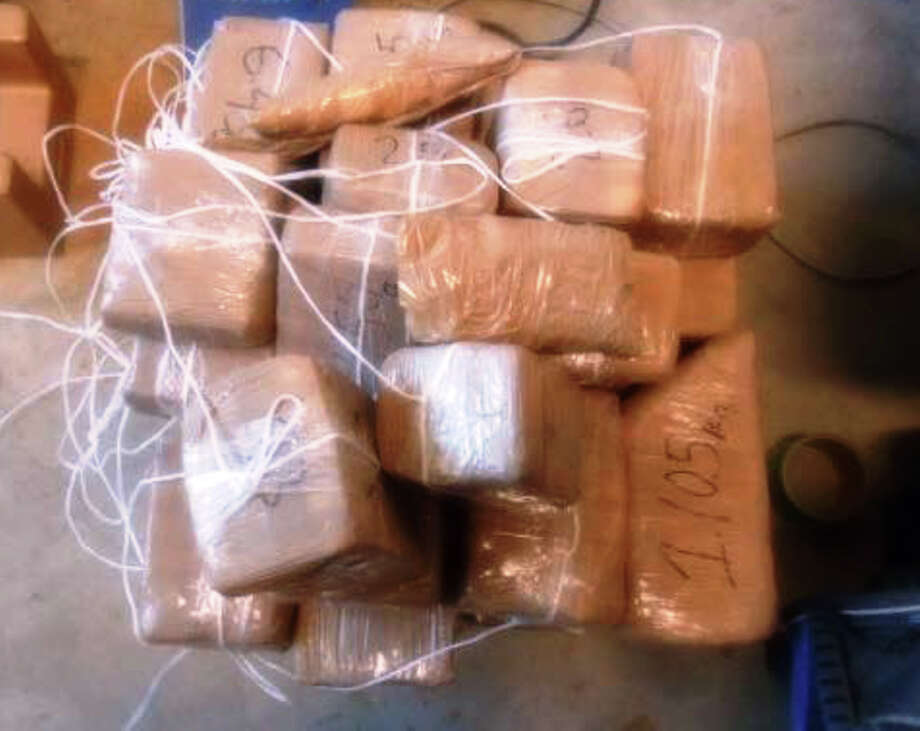 U.S. Customs and Border Protection officers seized more than $2 million in methamphetamine and Cocaine over the weekend. These packages of meth were among 41 found inside a truck to the Anzalduas International Bridge on Sunday. Photo: U.S. Customs And Border Protection